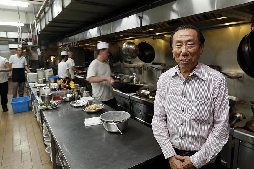 Mr Tan Kweng Nam in the kitchen of Boon Lay Raja. -- ST PHOTO: LAU FOOK KONG