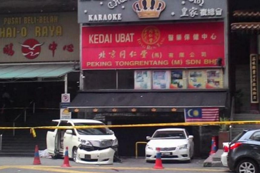 At least 14 people, including two women, were injured after a grenade exploded in front of the Sun Complex in Jalan Bukit Bintang here on Thursday.-- PHOTO: THE STAR/ASIA NEWS NETWORK