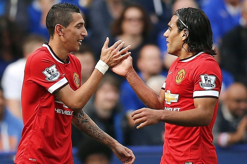 Manchester United's Angel Di Maria (left) celebrates with team-mate Radamel Falcao after scoring a goal against Leicester City during their English Premier League soccer match at the King Power stadium in Leicester, northern England on Sept 21, 2014.