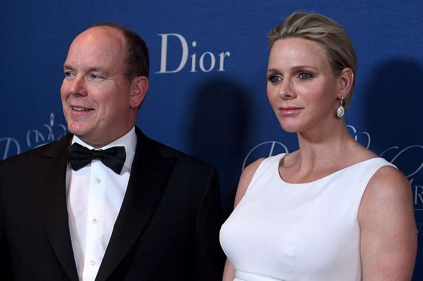His Serene Highness Prince Albert II of Monaco (left) and Her Serene Highness Princess Charlene of Monaco attend 2014 Princess Grace Awards Gala at Regent Beverly Wilshire Hotel on Oct 8, 2014 in Beverly Hills, California.Princess Charlene, the