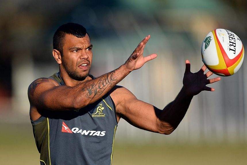 """Australian rugby team player Kurtley Beale catching the ball during a training session in Sydney on July 2, 2013.Troubled Wallabies back Kurtley Beale will miss next week's Test against the All Blacks amid fresh allegations over """"deeply offensi"""