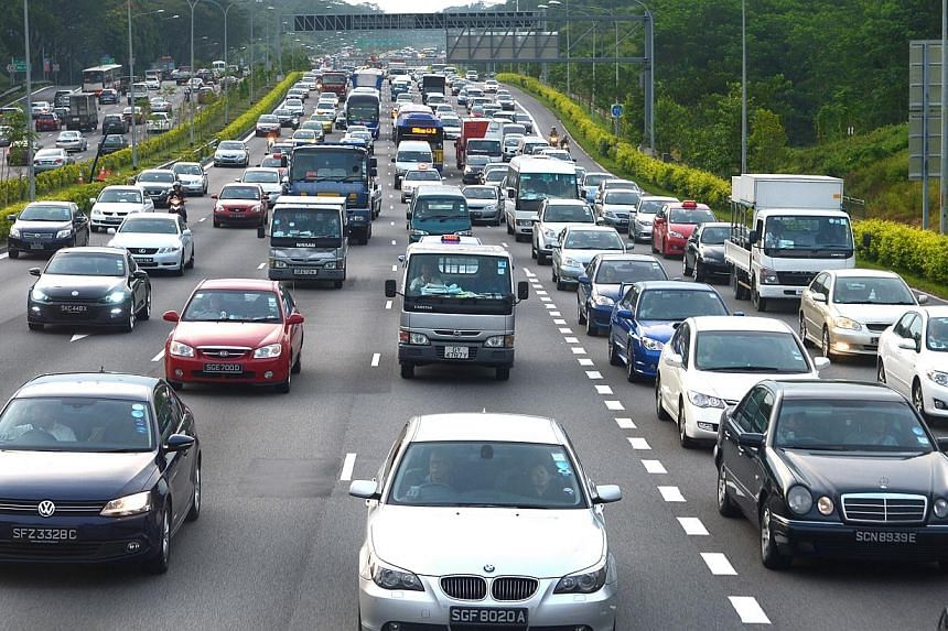 The traffic along PIE on the evening of Sept 8, 2014.Certificates of entitlement (COE) premiums finished higher at the latest tender Thursday, with the exception of Open category. -- PHOTO: ST FILE
