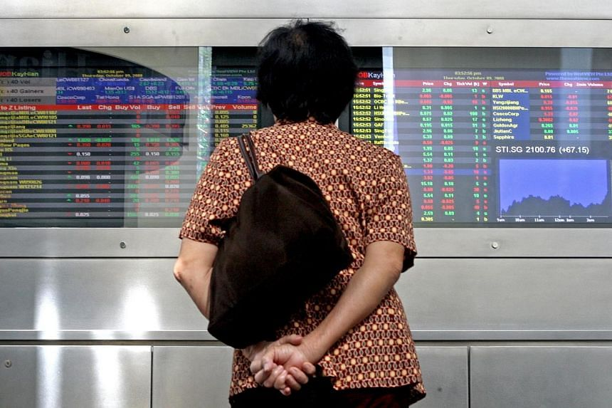 Local shares rose 1 per cent on Thursday as investors bet that interest rates would be kept low in the light of expected slow global economic growth. -- PHOTO: ST FILE