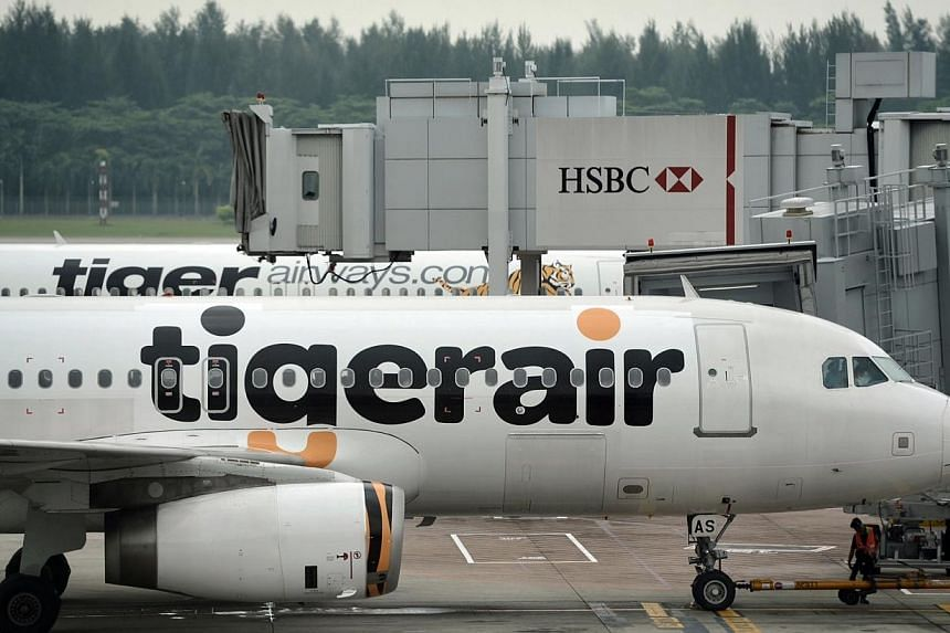 Tiger Airways Holdings will sublease 12 of its aircraft to Indian budget carrier InterGlobe Aviation in a move to reduce excess capacity and cut costs. -- PHOTO: ST FILE