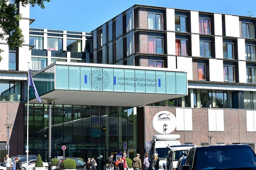 Television news crews working in front of the UKE university hospital in Hamburg, northern Germany, where a patient infected with the Ebola virus had been brought after landing at the airport on Aug 27, 2014.A third UN employee infected with th