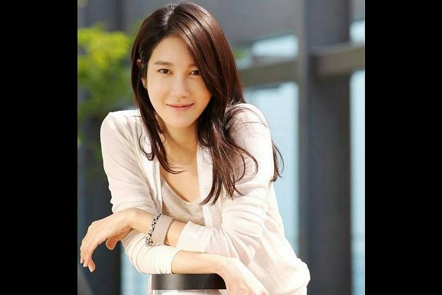 Lee Ji Ah, 36. -- PHOTOS: HIM INTERNATIONAL MUSIC, ST FILE, AGENCE FRANCE-PRESSE, THE NEW PAPER FILE, APPLE DAILY, JOH