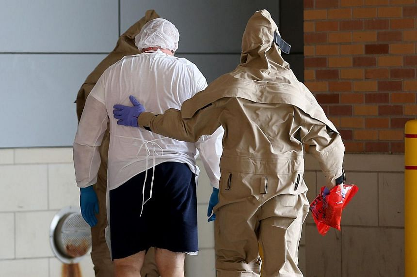 A possible Ebola patient is brought to the Texas Health Presbyterian Hospital in Dallas, Texas, on on Oct 8, 2014. -- PHOTO: AFP