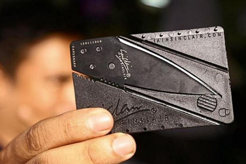 Not just a credit card: The innocuously disguised pocket blade camouflaged as a credit card can be slipped easily into the credit card compartment of a wallet and becomes a fatal knife within seconds. -- PHOTO: THE STAR/ASIA NEWS NETWORK