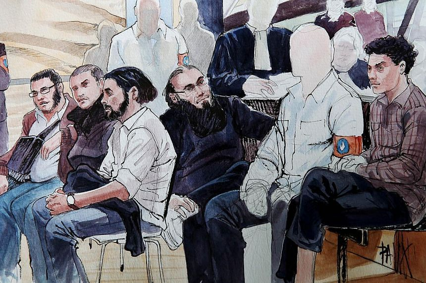 A court sketch shows Jejoen Bontinck (third from left) and Fouad Belkacem (fourth from left) on the first day of the trial of a suspected militant group at Anwerp criminal court on Sept 29, 2014. Hardline Islamist Fouad, accused of inspiring dozens o