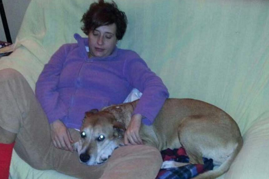 Teresa Romero Ramos, the Spanish nurse who contracted Ebola, is pictured with her dog Excalibur in this undated handout photo provided on Oct 8, 2014. Madrid regional authorities said they would euthanise the nurse's dog Excalibur to avoid possible c