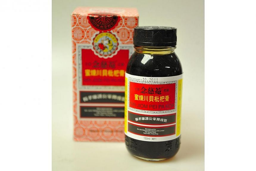 Chinese herbal syrup Nin Jiom Pei Pa Koa is a popular remedy for sore throat and cough.-- PHOTO: ST FILE