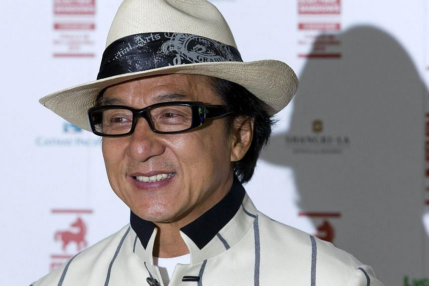Hong Kong actor Jackie Chan poses for photographers at a special screening of his film, Chinese Zodiac in central London on Aug 12, 2014. -- PHOTO: AFP