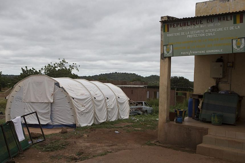 An isolation tent for people suspected to have Ebola is seen at the border with Guinea in Kouremale, on Oct 2, 2014. Singapore-based commodities trader Olam International has restricted its staff from travelling to parts of West Africa - Guinea, Libe