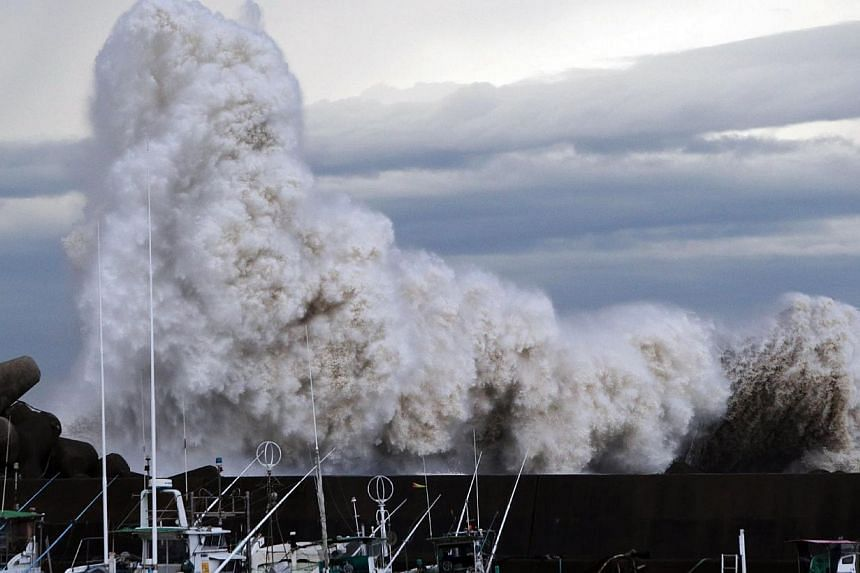 High waves from typhoon Phanfone batter a breakwater at a port at Kihou town in Mie prefecture, central Japan on Oct 6, 2014. -- PHOTO: AFP
