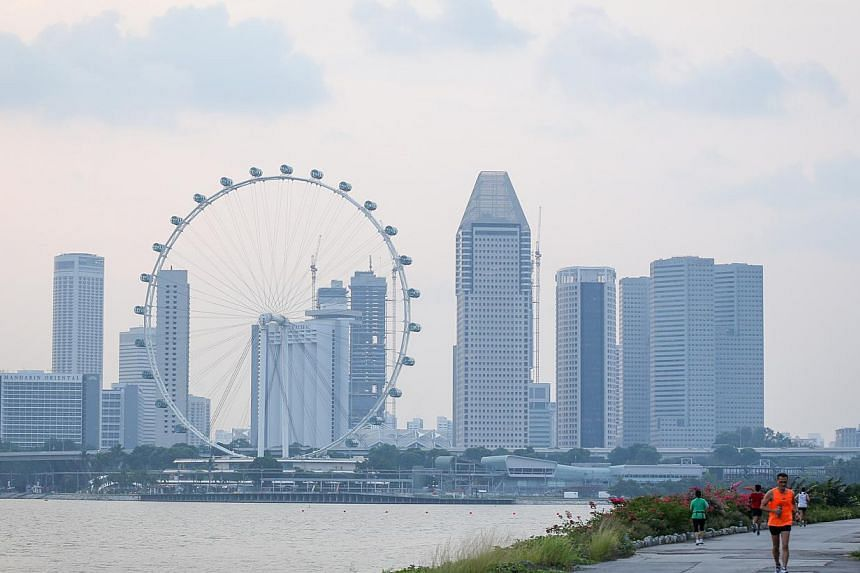 "Hazy skies at the Skyline Promenade, Gardens by the Bay (Bay East), on Oct 17, 2014. Some 1,000 sensors will be rolled out throughout Singapore to track everything from air quality and water level to public safety as the Government' ""smart nation"" pl"