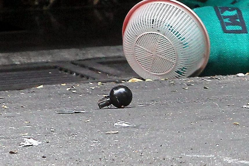 The grenade blasts in Malaysia's Bukit Bintang that killed one person and injured many were reportedly targeted at a top gangster involved in a boiling war on online gambling.-- PHOTO: THE STAR/ASIA NEWS NETWORK