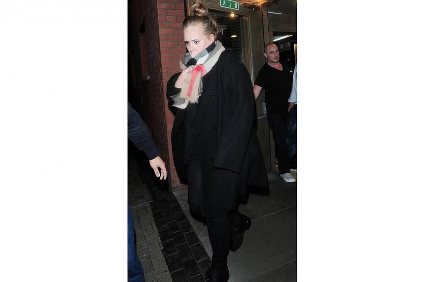 A much slimmed down Adele was spotted in Hackney in London watching English singer-songwriter FKA Twigs in concert. -- PHOTO: SNAPPER MEDIA