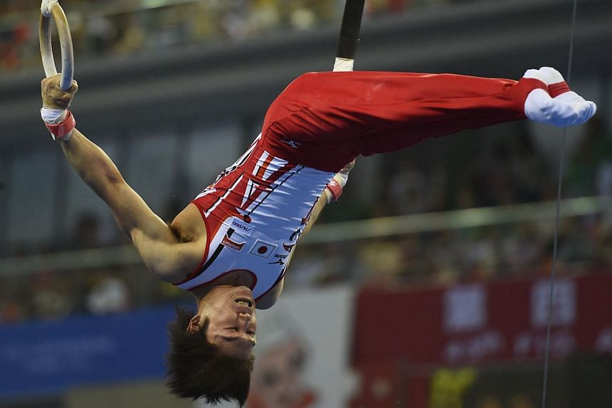 Japan's gymnast Kohei Uchimura performs on the ring during the men's all-around final at the Gymnastics World Championships in Nanning on Oct 9, 2014.Japan's Kohei Uchimura promised not to halt his relentless quest for perfection, despite seali