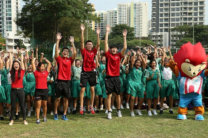 Newly-minted Asian Games gold medalists Savannah Siew (left) and Kimberly Lim (second from left) return to Tanjong Katong Girls' School to share their inspiring stories of heartbreak and triumph in sport with students of Tanjong Katong Girls' School