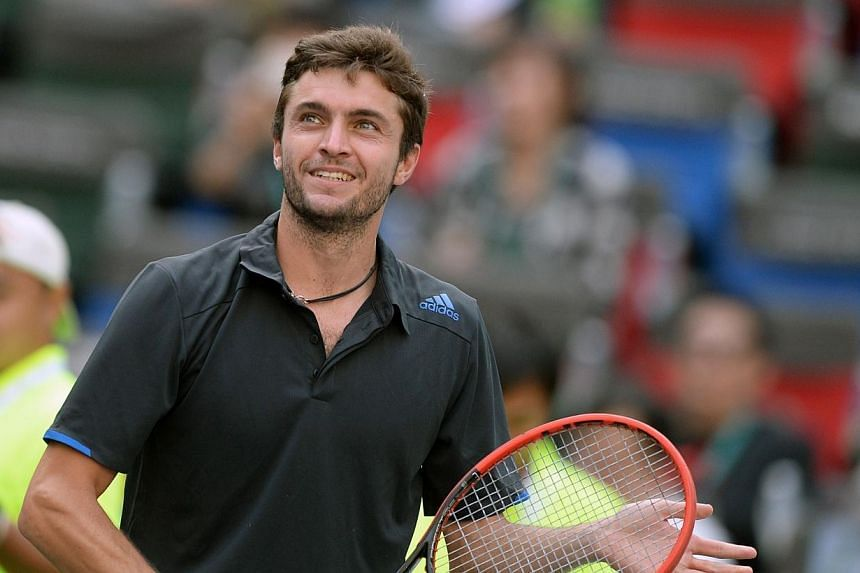 Gilles Simon of France reacts after defeating Tomas Berdych of Czech Republic during their quarter finals men's singles match at the Shanghai Masters 1000 tennis tournament held in the Qizhong Tennis Stadium in Shanghai on Oct 10, 2014.Unseeded