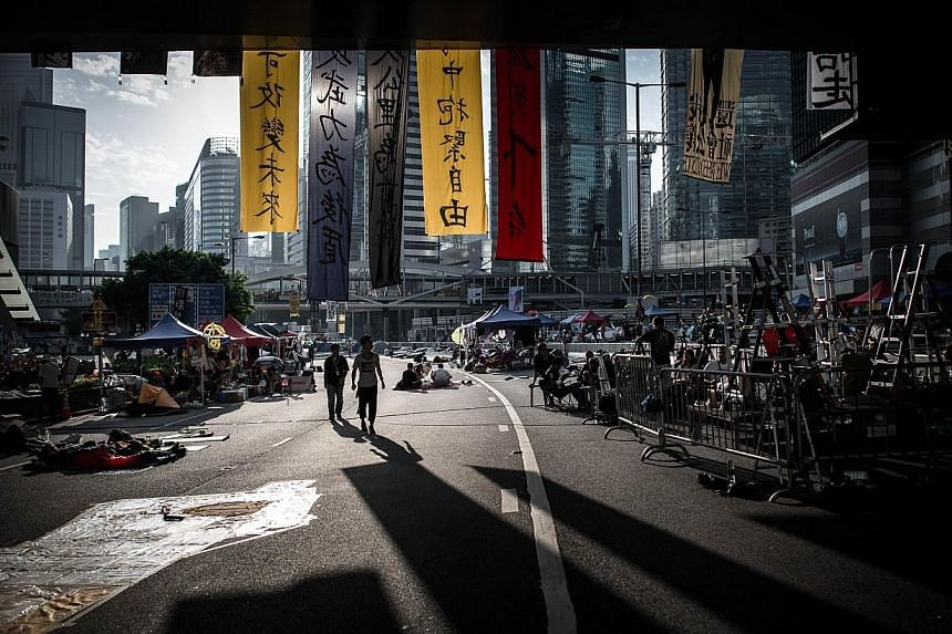 Pro-democracy demonstrators on a highway where the main protest site is located in Hong Kong on Oct 10, 2014.Hong Kong protesters planned a fresh show of force with a major rally on Friday as they won powerful new US backing in their camp