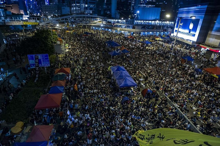 Pro democracy protesters gather at Admiralty district during the rally after government called off the talks with students on Oct 10, 2014 in Hong Kong. -- PHOTO: AFP