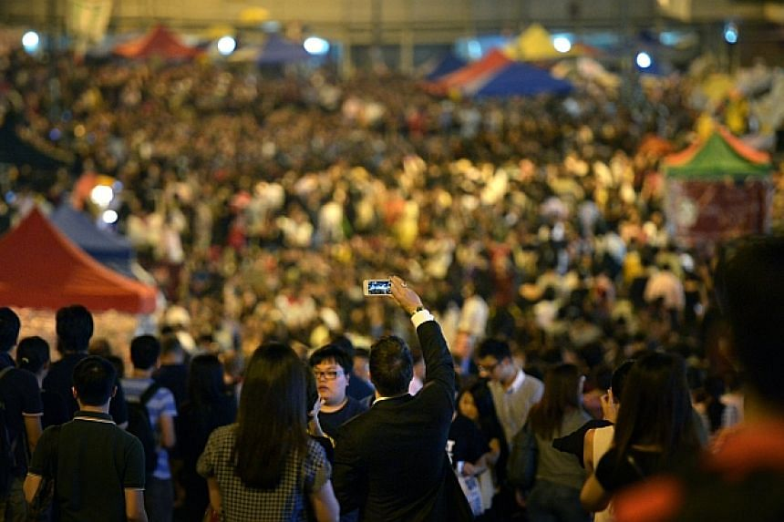 Protest organisers urged people to turn up in force at Admiralty, the main protest site in Hong Kong at 730pm on Oct 10, 2014, as a response to the government's withdrawal from the scheduled talks today. -- ST PHOTO: KUA CHEE SIONG
