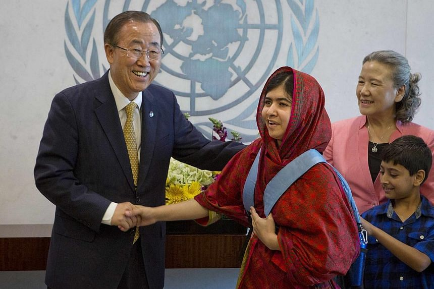 Pakistani schoolgirl activist Malala Yousafzai poses for pictures with United Nations Secretary General Ban Ki-moon during a photo opportunity at the United Nations in the Manhattan borough of New York on Aug 18, 2014. -- PHOTO: REUTERS