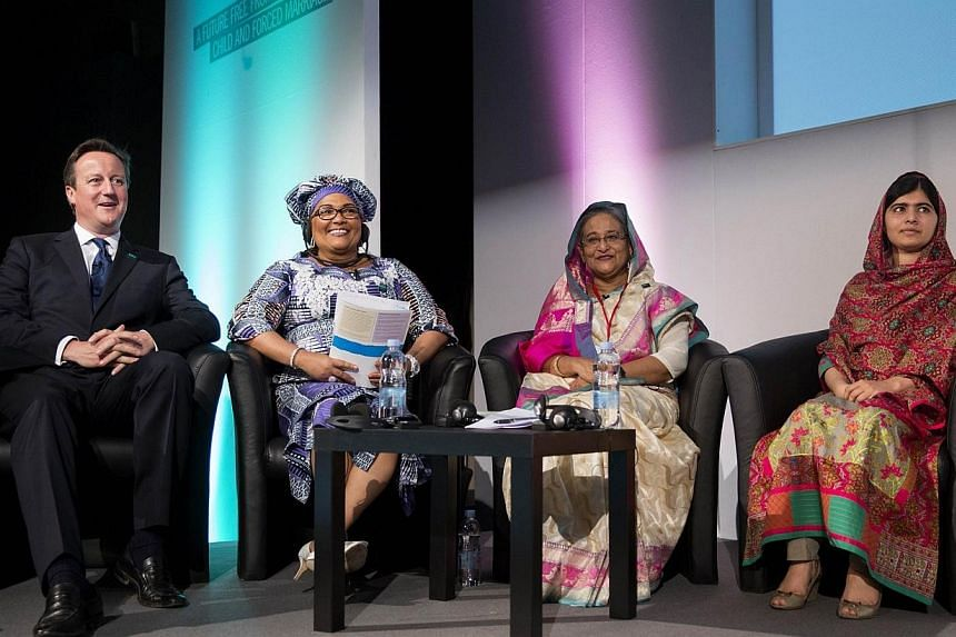 British Prime Minister David Cameron (left) sits with Chantal Compaore (second left), the First Lady of Burkina Faso, Sheikh Hasina Wajed (second right), the Prime Minister of Bangladesh, and Pakistani rights activist Malala Yousafzai (right) at the