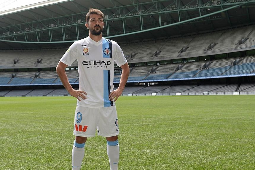 Spain's striker David Villa in his new Melbourne City Football Club (MCFC) kit during the A-League 2014/15 season launch at Etihad Stadium in Melbourne on Oct 7, 2014. Former Spain striker David Villa will definitely make his A-League footb