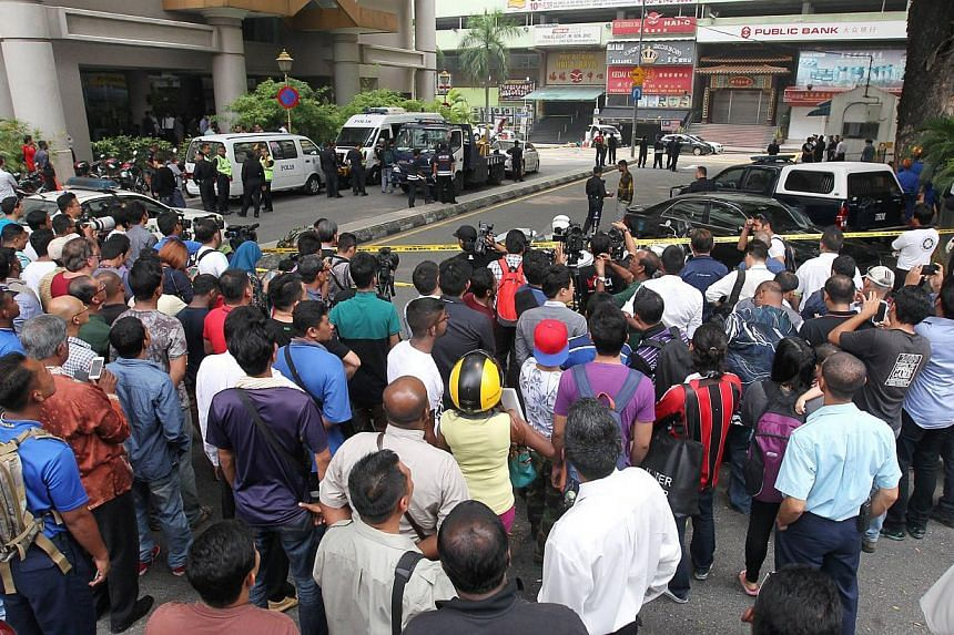 An intact grenade found at the scene. It is understood that there were two grenades and one did not explode. The grenade that went off left Malaysian Tiong Kwang Yie, 36, dead and 13 others injured. Police at the scene of the grenade blast in the pop