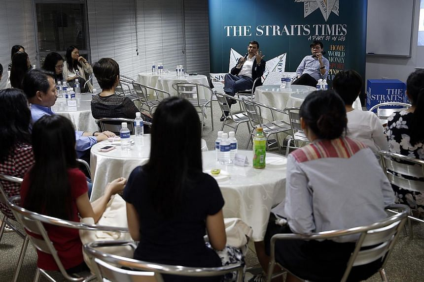 Straits Times editor Warren Fernandez (left, facing the audience) and ST Forum editor Jack Hee interacting with participants yesterday at the first Straits Times Young Forum Writers' Gathering. The free session aims to encourage those below the age