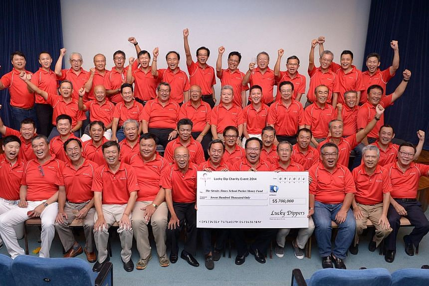 The Lucky Dippers, seen here with SPH's editor at large Han Fook Kwang (front row, sixth from left), aimed to raise $400,000 for The Straits Times School Pocket Money Fund and exceeded the target by $300,000. The group is into its fifth year of organ
