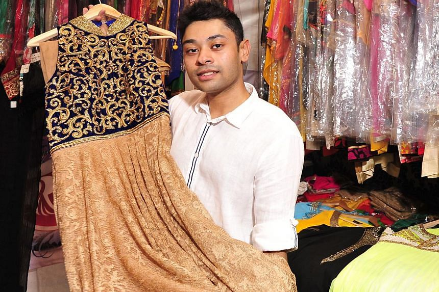 At the Deepavali Festival Village, buy intricate door hangings, sold by Ms Pushpa Jothi, or colourful anarkali gowns, sold by Mr Rajpal Singh (above), snack on traditional Indian fare such as kuzhi paniyaram and take a selfie with Hindu goddess Mahal