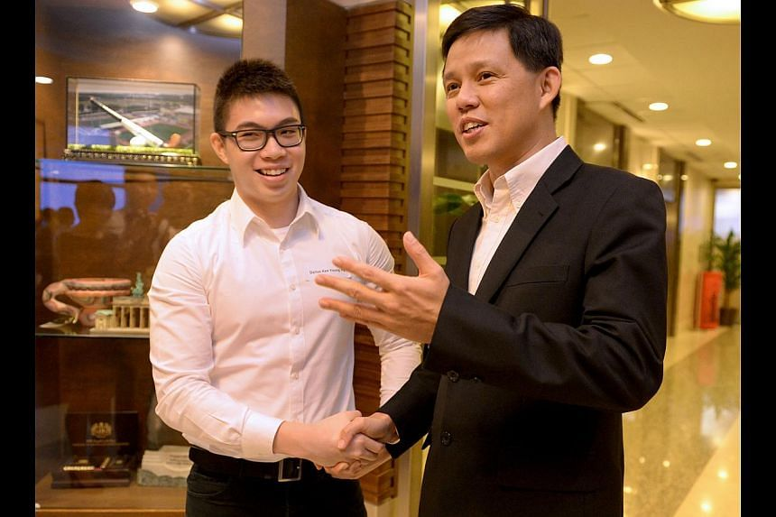 Minister for Social and Family Development Chan Chun Sing with Mr Darius Ng, a recipient of the Early Childhood Development Agency Polytechnic Training Award, at yesterday's ceremony to recognise recipients of ECDA scholarships and awards.