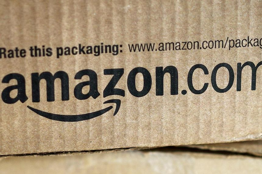 A just-delivered Amazon box is seen on a counter in Golden, Colorado on Aug 27, 2014.Online retail colossus Amazon.com plans to open its first brick-and-mortar store in New York ahead of the year-end holiday season, The Wall Street Journal repo