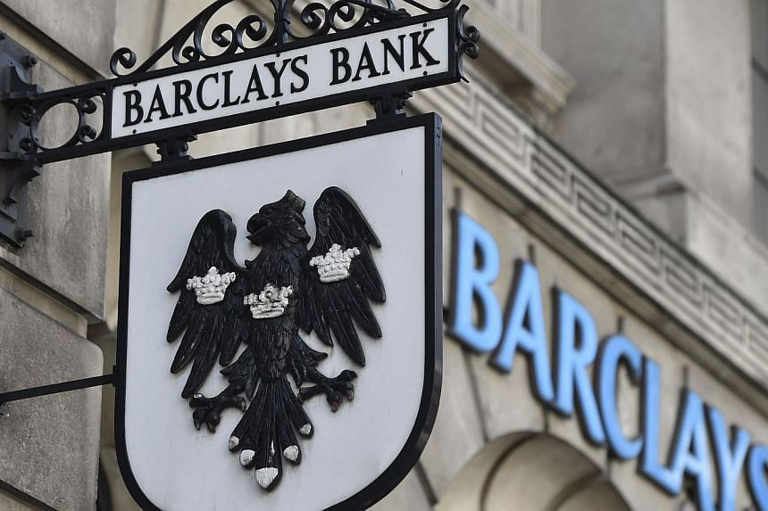 A Barclays sign hangs outside a branch of the bank in the City of London July 30, 2014.British bank Barclays agreed to pay US$20 million (S$25 million) to settle a class-action suit from investors who lost money in the Libor interest rate-riggi
