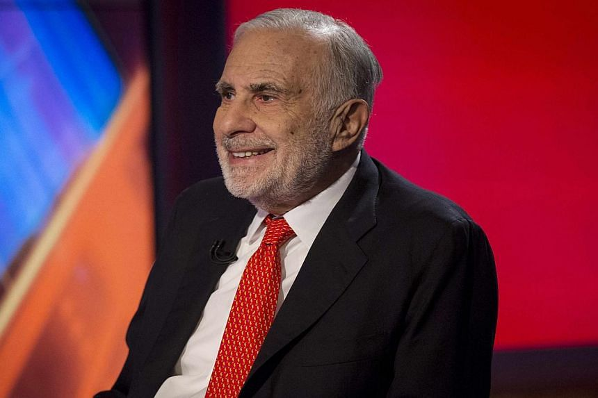 Billionaire activist investor Carl Icahn (above) said on Thursday that Apple's shares could double in value and urged the company's board to buy back more shares using its US$133 billion (S$169 billion) cash pile. -- PHOTO: REUTERS