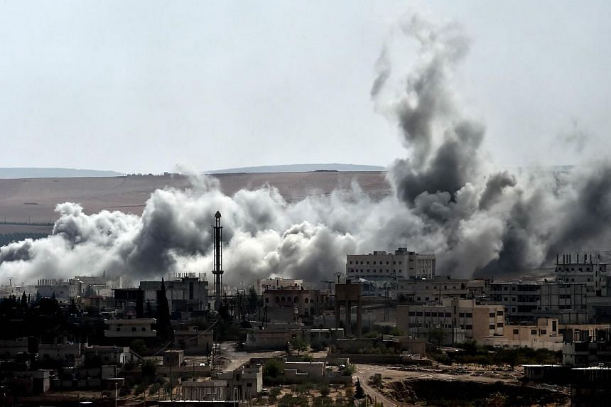 Smoke rises from an airstrike on the southwestern part of the Syrian town of Ain al-Arab, known as Kobane by the Kurds, as seen from the Turkish-Syrian border, in the southeastern Turkisk village of Mursitpinar, Sanliurfa province, on Oct 9, 2014.&nb