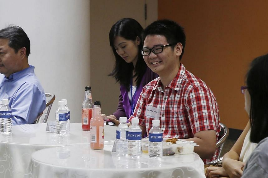 Student Lee Song Yang (in red) has had his letters published in The Straits Times Forum page five times this year.-- ST PHOTO: LAU FOOK KONG