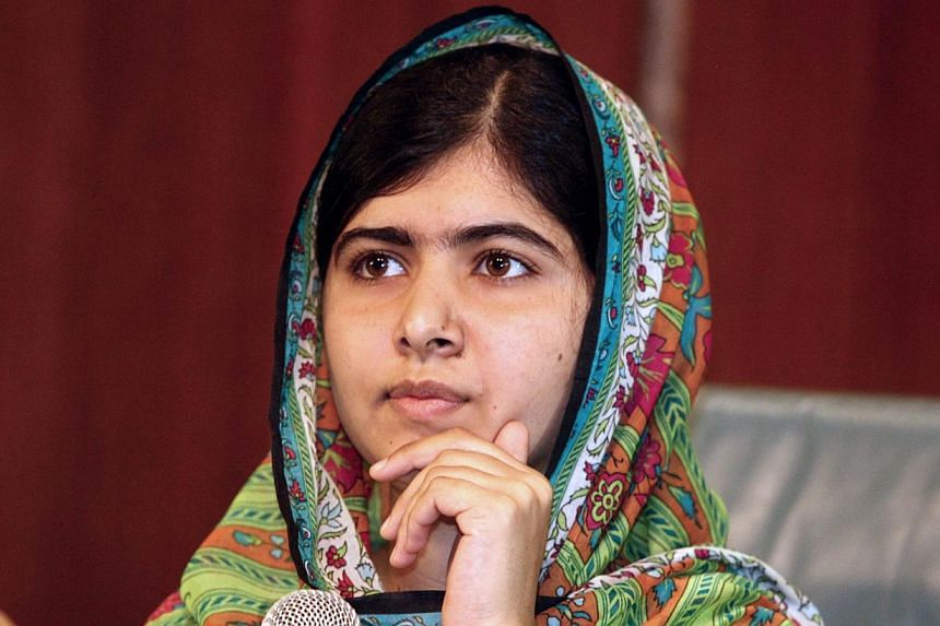 """Pakistan's Prime Minister Nawaz Sharif has congratulated teenage education campaigner Malala Yousafzai on winning the Nobel Peace Prize, calling her the """"pride"""" of his country. -- PHOTO: AFP"""