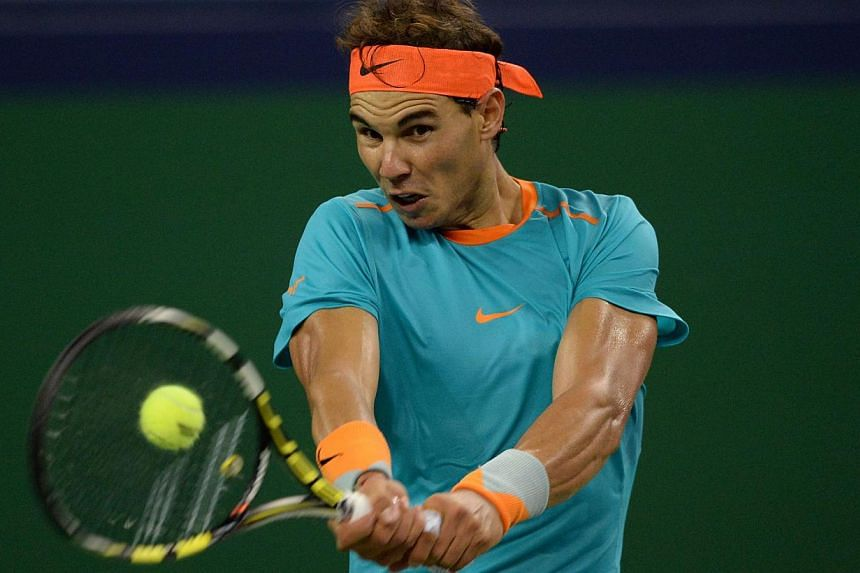 Rafael Nadal of Spain hits a return against Feliciano Lopez of Spain during their men's singles second round match at the Shanghai Masters 1000 tennis tournament held in the Qizhong Tennis Stadium in Shanghai on Oct 8, 2014. The world No. 2 returned