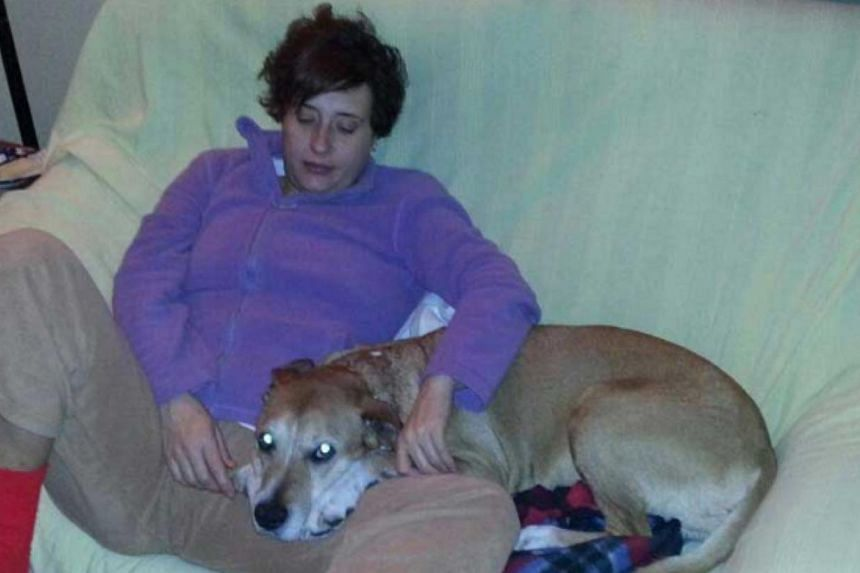 """Teresa Romero Ramos is pictured with her dog Excalibur in this undated handout photo provided on Oct 8, 2014. TheSpanish nurse, who is the first person known to have been infected with Ebola outside Africa, is at """"serious risk"""" of dying after h"""