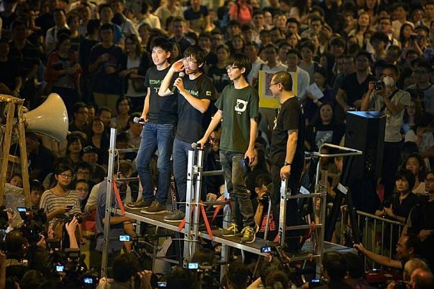 Protest organisers from left to right: Lester Shum, Alex Chow, Joshua Wong and Benny Tai addressing the crowd at Admiralty on Oct 10, 2014. -- ST PHOTO: KUA CHEE SIONG
