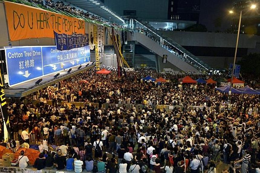 Thousands of protesters gather in Hong Kong's Admiralty district after the government called off the talks with students on Oct 10, 2014. -- ST PHOTO: KUA CHEE SIONG