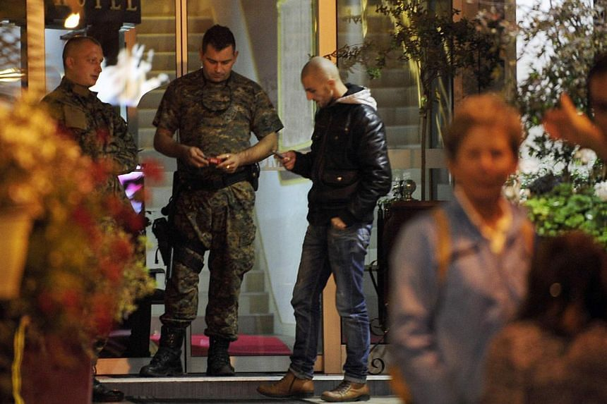 Police guard the entrance of a quarantined hotel in Skopje on October 9 where a British man showing symptoms of the Ebola virus died in Macedonia on Thursday. -- PHOTO: REUTERS