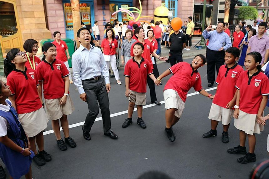 Mr Tan Chuan-Jin, Minister of Manpower, celebrating Children''s Day with more than 1,000 pupils under the Ministry of Education (MOE) Financial Assistance Scheme through a series of craft activities and theatre-dance performance staged by CHIJ (Kell