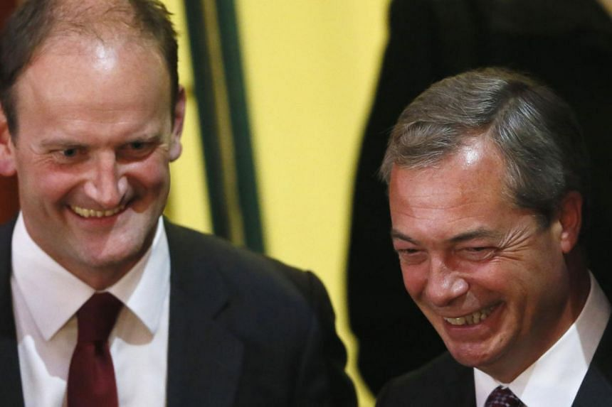 United Kingdom Independence Party (UKIP) candidate Douglas Carswell (L) and UKIP leader Nigel Farage at the Town Hall in Clacton-on-Sea in eastern England on Oct 10. Britain's anti-EU UKIP won its first elected seat in parliament on Friday.