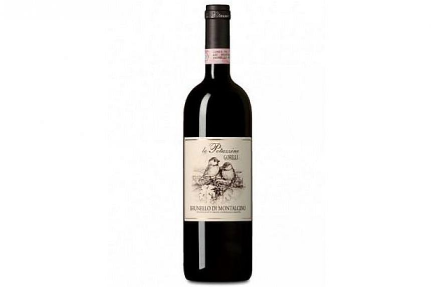 A bottle of Le Potazzine Brunello di Montalcino 2009 DOCG,one of the three premium Italian wines that have made it to the top 10 list of The Business Times Wine Challenge 2014 - CEOs' Choice.-- PHOTO: RICHFIELD BRANDS AND SERVICES PTE LTD