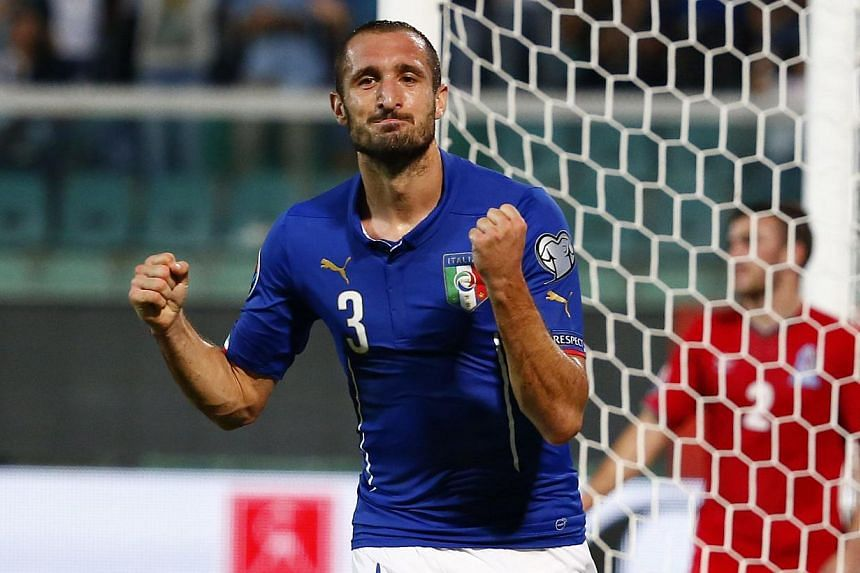 Italy's Giorgio Chiellini celebrates after scoring during the Uefa Euro 2016 group H qualifying football match between Italy and Azerbaijan at the Renzo Barbera Stadium in Palermo on Oct 10, 2014. -- PHOTO: AFP